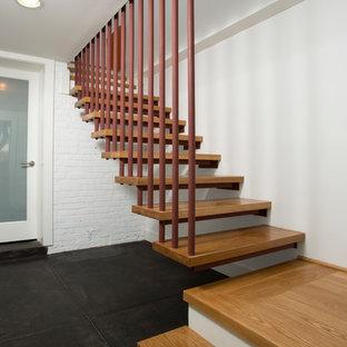 Свежая идея для дизайна: угловая лестница среднего размера в стиле модернизм с деревянными ступенями без подступенок - отличное фото интерьера