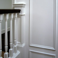Traditional Staircase by Upscale Construction