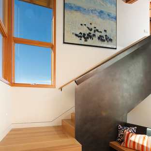 Inspiration for a contemporary wood l-shaped staircase in Other with wood risers.