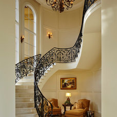 Mediterranean Staircase by Turtle Beach Construction & Remodeling