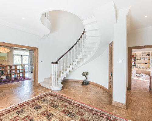 Photo Of A Classic Carpeted Curved Staircase In Berkshire With Carpeted  Risers.