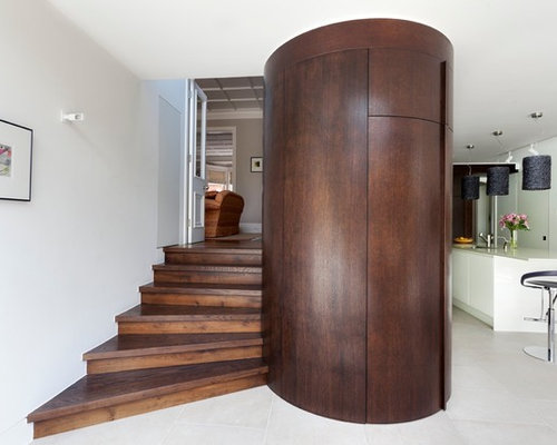 Trendy Wooden Straight Staircase Photo In London