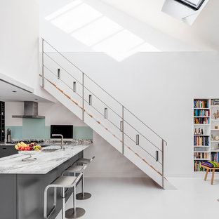 Inspiration for a medium sized contemporary wood straight wire cable railing staircase in London.