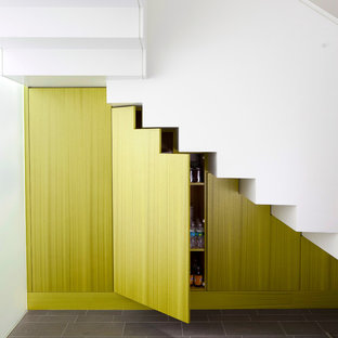 This is an example of a mid-sized contemporary l-shaped staircase in New York.