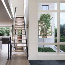 Contemporary Staircase by Kariouk Associates