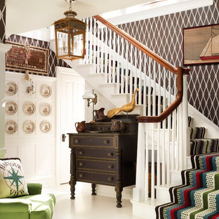 Staircase - beach style painted l-shaped staircase idea in New York with painted risers