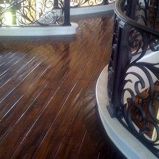 Mediterranean Staircase by WESTCOAST HARDWOOD FLOORS