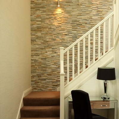 Transitional carpeted l-shaped staircase photo in Other with carpeted risers