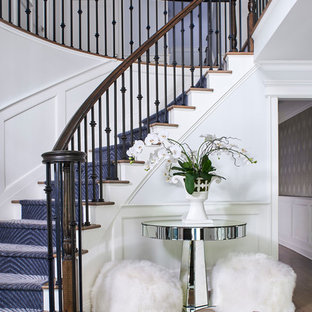 Staircase - transitional wooden curved mixed material railing staircase idea in New York with painted risers