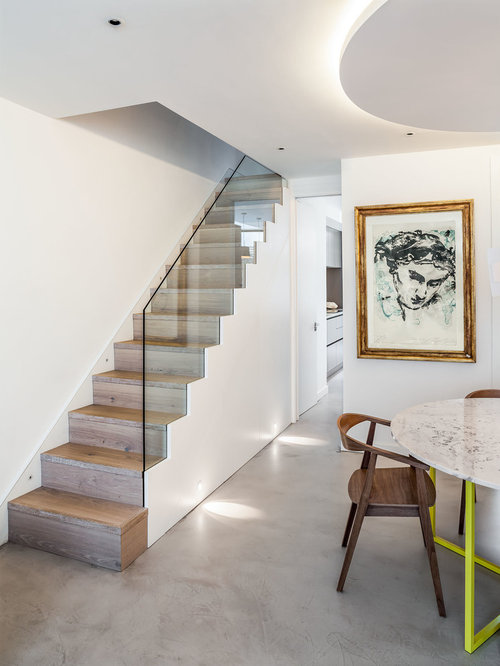 photo of a contemporary and modern wood straight staircase in london with wood risers - Stairs Design Ideas