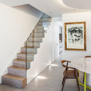 Design ideas for a contemporary wood straight staircase in London with wood risers.
