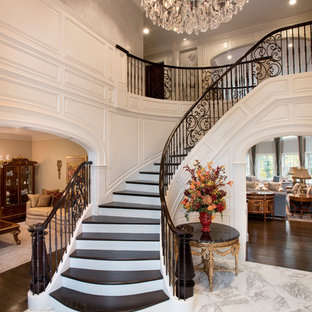 Example of a classic wooden curved mixed material railing staircase design in Boston with painted risers