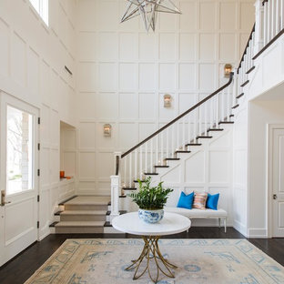 Large transitional wooden u-shaped wood railing staircase photo in Dallas with painted risers