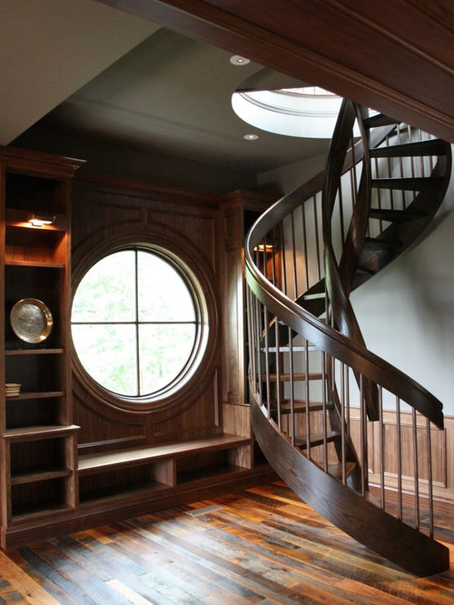 Craftsman interior wrought iron stair railing home design for Round staircase designs interior