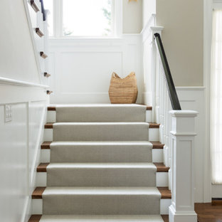 Transitional carpeted u-shaped wood railing staircase photo in Boston with carpeted risers