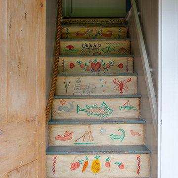 Whimsical Staircase with Hand Painted Seaside Art - Custom Home Renovation - Cap