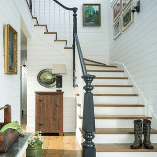 Farmhouse wooden l-shaped staircase photo in Burlington