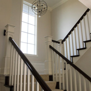 Staircase - large contemporary carpeted u-shaped wood railing staircase idea in Grand Rapids with carpeted risers
