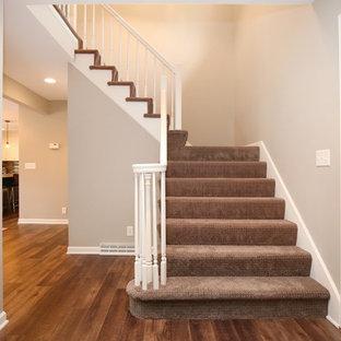 Elegant staircase photo in Grand Rapids