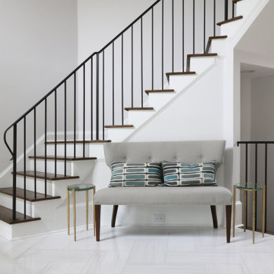 Staircase - large transitional wooden curved metal railing staircase idea in Atlanta with painted risers