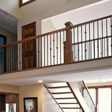 Transitional Staircase by Distinctive Remodeling Solutions, Inc