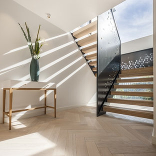 Inspiration for a contemporary wood u-shaped staircase in Dorset with open risers.