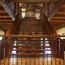 Traditional Staircase by Legends West Reclaimed Lumber