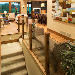 Inspiration for a large craftsman carpeted straight staircase remodel in Minneapolis with carpeted risers