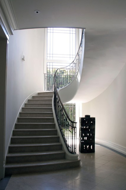 traditional staircase by Studio William Hefner