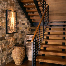 rustic staircase by Poss Architecture + Planning + Interior Design