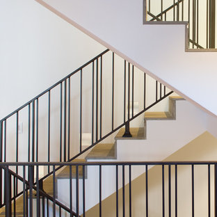 Example of a mid-sized transitional u-shaped staircase design in San Diego with concrete risers