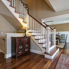 Traditional Staircase by Redstart Construction Inc.