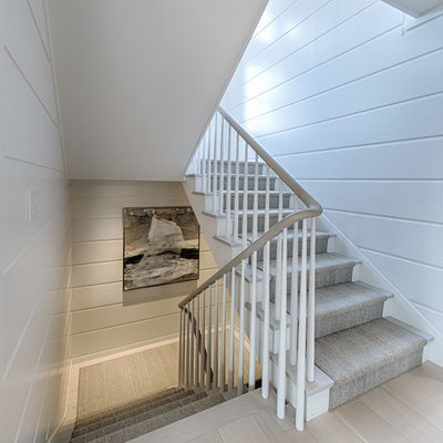 Beach style wooden u-shaped wood railing staircase photo in Boston with painted risers