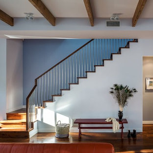 Staircase - contemporary wooden l-shaped staircase idea in New York with wooden risers