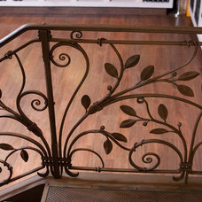 Traditional Staircase by shawn lovell metalworks
