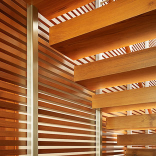 Large zen wooden straight open and wood railing staircase photo in Los Angeles