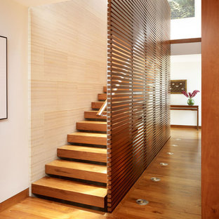 Example of a large wooden straight open and wood railing staircase design in Los Angeles