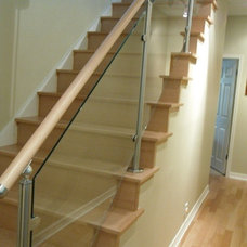 Contemporary Staircase by Designers Hardwood Floors LLC