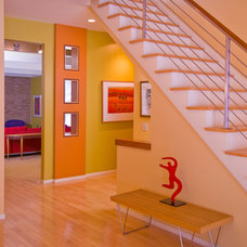 Eclectic Staircase by Custom Design/Build, Inc.