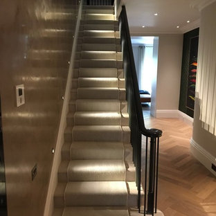 Inspiration for a large timeless marble straight metal railing staircase remodel in London with marble risers
