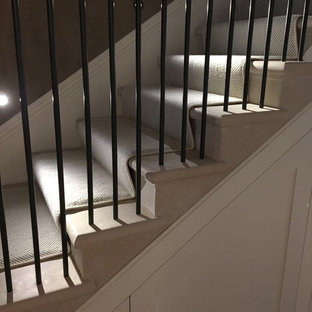 Staircase - large traditional marble straight metal railing staircase idea in London with marble risers