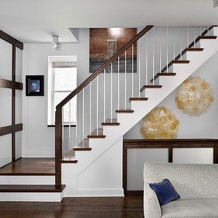 Staircase - transitional wooden staircase idea in Chicago
