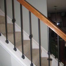 Traditional Staircase by The Finishing Company