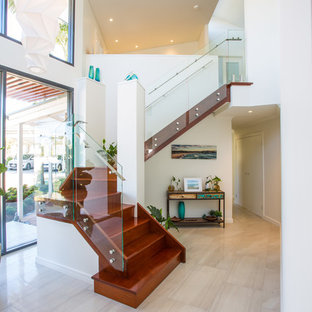 Contemporary wood u-shaped staircase in Brisbane with wood risers and glass railing.