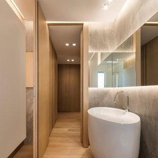Esempio di una stanza da bagno minimal con pareti grigie e lavabo a colonna