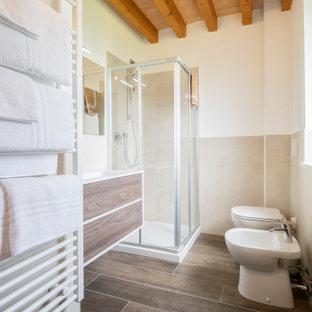 Immagine di una stanza da bagno con doccia design di medie dimensioni con ante lisce, ante in legno scuro, doccia ad angolo, piastrelle beige, pareti bianche, lavabo integrato, pavimento marrone, porta doccia a battente e top bianco