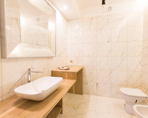 Stanza da bagno contemporanea con piastrelle di marmo foto idee
