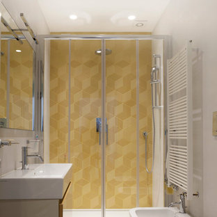 Design ideas for a small contemporary 3/4 bathroom in Milan with flat-panel cabinets, beige cabinets, an alcove shower, a two-piece toilet, yellow tile, terra-cotta tile, white walls, porcelain floors and a trough sink.