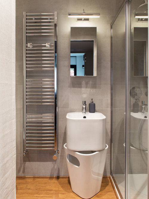 Powder Room Design Ideas, Remodels & Photos with White Cabinets and Light Hardwood Floors