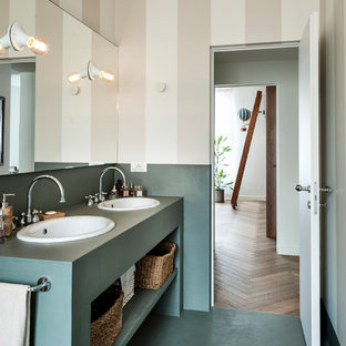 Design ideas for a contemporary bathroom in Milan with open cabinets, green cabinets, green floor, beige walls, a drop-in sink and green benchtops.